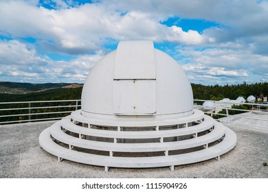Dome of special astrophysical observatory on blue sky background at sunny day