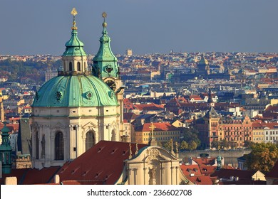 Dome of St Nicholas Church (Cathedral) surrounded by orange roof tops of Mala Strana, Prague, Czech Republic