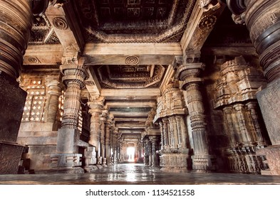 Dome and stone corridor inside the 12th century stone temple Hoysaleswara in India
