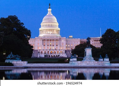The dome of the United States Capitol building, seen from the the Capitol Reflecting Pool, Washington DC, USA.