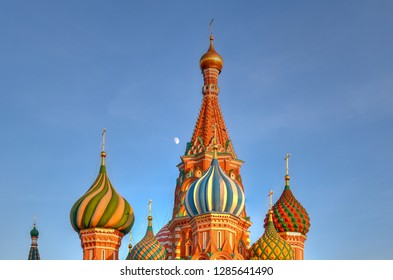 Domes of the Cathedral of Vasily the Blessed (Saint Basil's Cathedral) against a blue sky in Red Square in Moscow, Russia