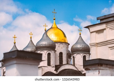 Domes of church at Novgorod kremlin, Russia. Blue cloudy sky in background. Russian architecture.