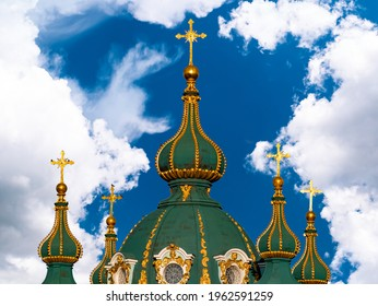 Domes with a cross of a Christian church. Christian cross. Religion and culture. Orthodox church. Blue sky. White clouds. Merry Christmas. Easter holidays. Background image.
