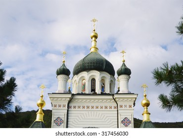 Domes of foros Church of Holy Resurrection of Christ, closeup on blue sky, Crimea