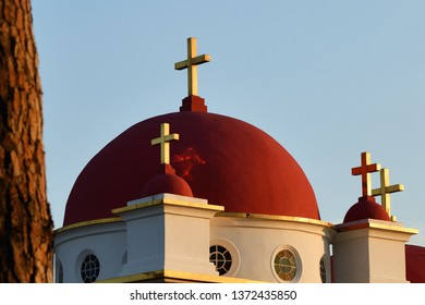 Domes of the the Greek Orthodox Church of the Holy Apostles in Capernaum near the shore of the Sea of Galilee in Israel shown at sunset