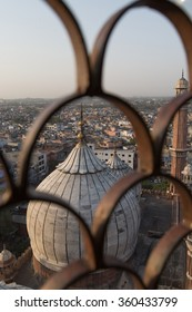 Domes of Jama Masjid mosque and the city of Delhi seen from  the top of a minaret