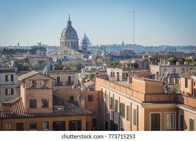 The domes and rooftops of the eternal city, the view from the Spanish steps, Rome, Italy, sunny day and blue sky