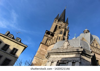 The Domes, the side view from the bottom and the details of Aachen Cathedral at sunset. Facade of Aix-la-Chapelle, Roman Catholic church in Aachen, western Germany.