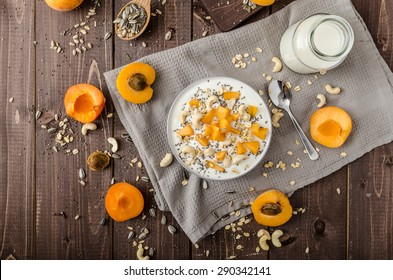 Domestic apricots musli yogurt with milk and crispy nuts and healthy seeds chia