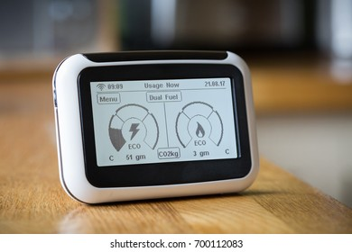 Domestic Energy Smart Meter on a Kitchen Worktop Displaying Carbon Emissions in Real Time