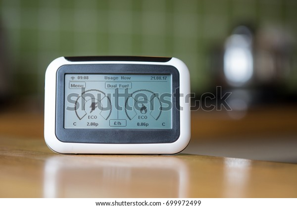 Domestic Energy Smart Meter on a Kitchen Worktop Displaying Electricity and Gas Usage in Real time