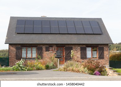 Domestic house with solar panels producing alternative energy