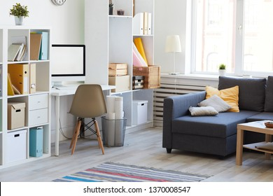 Domestic interion in white and blue with home workplace in living room, copy space
