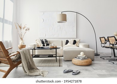 Domestic interior of living room with design modular sofa, black coffee table, lamp, armchair, decoration, art paintings and elegant personal accessories in modern home decor. Template. - Shutterstock ID 1954271878