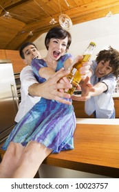 domestic life: friends competing for the last beer