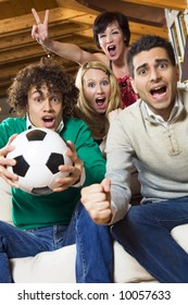 domestic life: group of friend watching soccer on tv