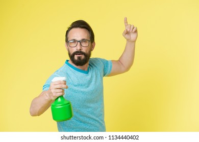 domestic service. man from domestic service with spray in glasses. domestic service advertisement. single man needs domestic service. ready to clean