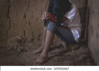 Domestic and sexual violence ,sad little girl hands with rope imprisoned in old room ,trafficking concept.rape and violence,