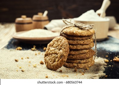 Domestic stacked biscuit sweet cookie with the sesame,peanuts,sunflower background on wooden table close up