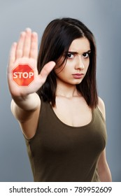 Domestic violence and abuse concept. Upset woman showing hand stop sign