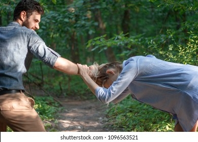 domestic violence, abuse and people concept - couple having fight and man dragging helpless woman by hair