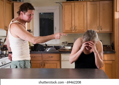 domestic violence - man threatens battered woman