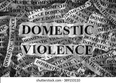 Domestic violence. Torn pieces of paper with the words Domestic violence. Concept Image. Black and White. Closeup.