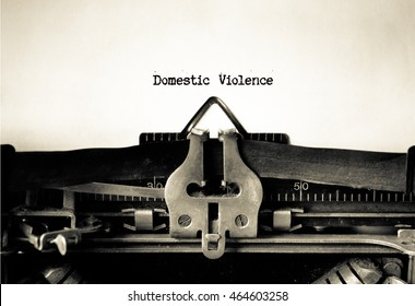 domestic violence words typed on a vintage typewriter