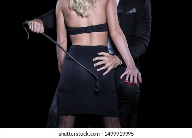 Dominant rich man grab blonde woman ass and holding whip, bdsm