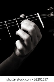 Dominant seventh chord (A7) on classical guitar; toned monochrome image;