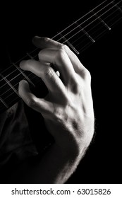 Dominant seventh chord (A7) on electric guitar; toned monochrome image