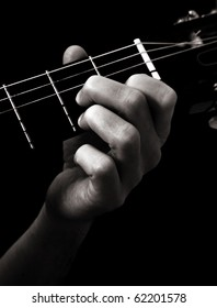 Dominant seventh chord (D7) on classical guitar; toned monochrome image