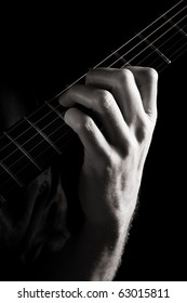 Dominant seventh chord (E7) on electric guitar; toned monochrome image