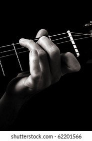 Dominant seventh chord (G7) on classical guitar; toned monochrome image