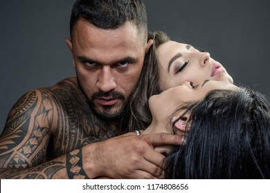 Dominantning in the foreplay sexual game. Man playing domination games. Concept of sensual and intimate moment of lovers. Sexy evening for young couple and sex protection