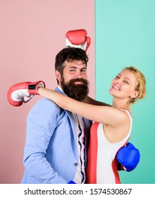 dominating. problems in relationship. sport. family couple boxing gloves. knockout punching. who is right. win the fight. Strength and power. bearded man hipster fighting with woman.