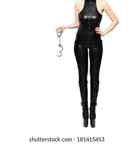 Dominatrix holding handcuffs, isolated on white background