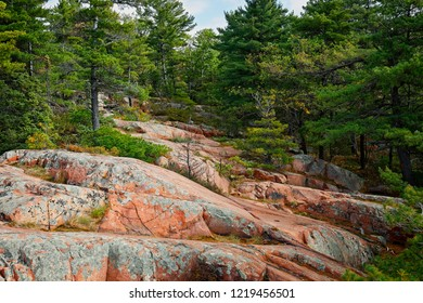 The dominent rock formation throughout Killarney Provincial Park in Northern Ontario is pink granite, although the west side of the Park also features prominent outcroppings of white quartzite.