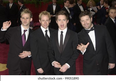 DOMINIC MONAGHAN (left), BILLY BOYD, ELIJAH WOOD & SEAN ASTIN at the 76th Annual Academy Awards in Hollywood. February 29, 2004