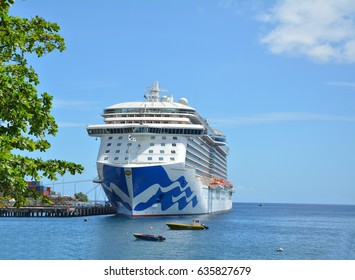 DOMINICA, CARIBBEAN - MARCH 24, 2017 : Royal Princess ship docked in Roseau port. Royal Princess is operated by Princess Cruises line and has a capacity of 3600 passengers
