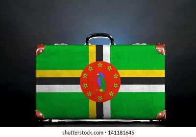 The Dominica flag on a suitcase for travel.