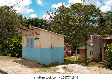 Dominican Republic, 10 april, 2019 // Road trip driving in the Dominican Republic: typical caribbean landscapes and colored houses