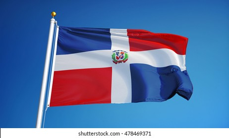 Dominican Republic flag waving against clean blue sky, close up, isolated with clipping path mask alpha channel transparency