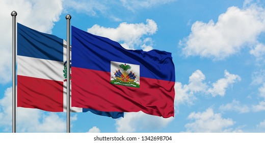 Dominican Republic and Haiti flag waving in the wind against white cloudy blue sky together. Diplomacy concept, international relations.