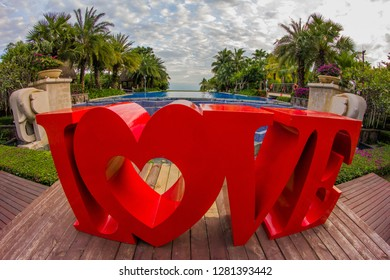 Dominican Republic, Punta Cana, Bavaro - January 5, 2019. Celebration of St. Valentine's Day on the tropical islands. luxury vacation. Inscription love on the background of exotic palms .