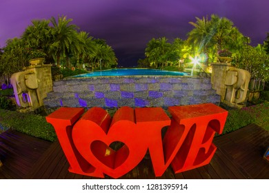 Dominican Republic, Punta Cana, Bavaro - January 5, 2019. Celebration of St. Valentine's Day on the tropical islands. luxury vacation. Inscription love on the background of exotic palms and night sky