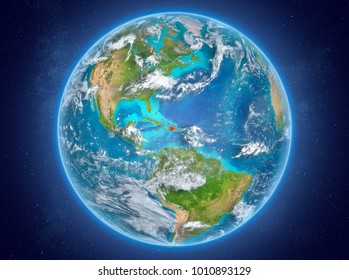 Dominican Republic in red on model of planet Earth with clouds and atmosphere in space. 3D illustration. Elements of this image furnished by NASA.