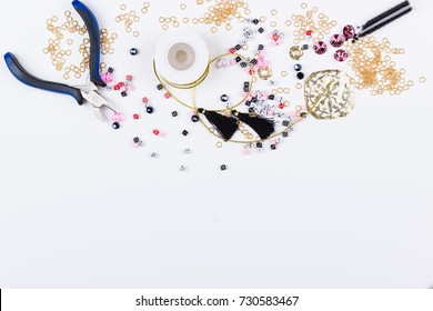 Domino beads and components for jewelry making on white background. Top view. Space for text.