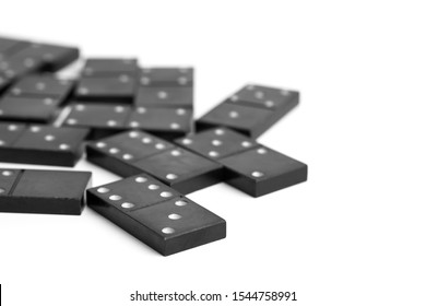 Domino chips close up. Scattered black dominoes. Dominoes top view. Black domino figures.