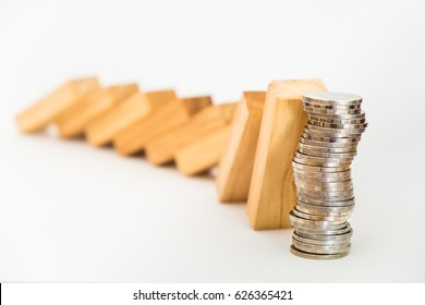 Domino effect to coin stack, Business concept